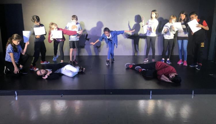 Drama 6 - tableau work (beginning stage composition) showing children protesting against UN politicians over climate change
